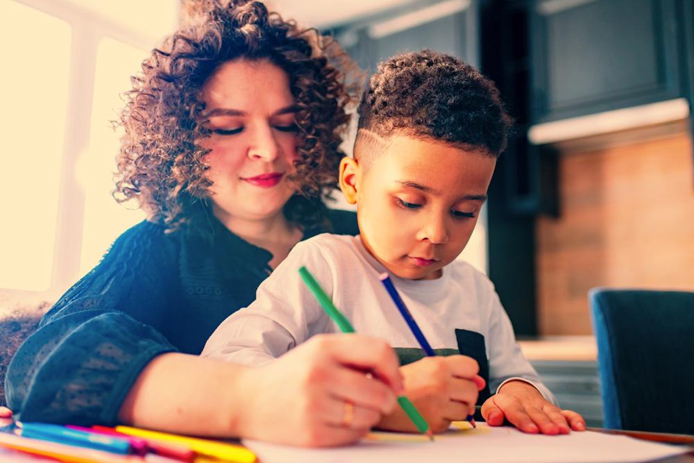 Mum and son crayoning